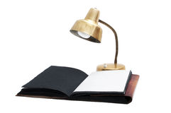Desk lamp and old book. Isolated on white background Royalty Free Stock Photography