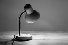 Desk lamp on table Stock Photography