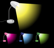 Desk Lamps turned on Stock Images