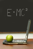 Desk with laptop and green apple Royalty Free Stock Photo