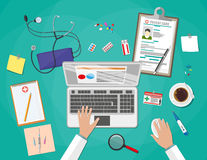 Desk with laptop, medical and healthcare devices Royalty Free Stock Photo