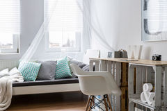 Desk made of wooden boxes in stylish bedroom Stock Images
