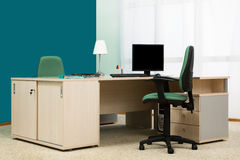 Desk in a modern office. Laptop and computer on a desk in a modern office Stock Photography