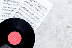 Desk of musician for songwriter work set with vynil record and notes stone background top view mockup Stock Image