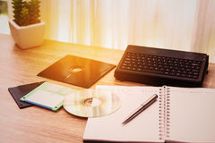 Desk with note ,floppy disk A, floppy disk B and memory drive in home office, private office and modern desk in modern life Stock Photography