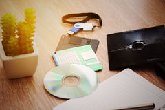 Desk with note ,floppy disk A, floppy disk B and memory drive in home office, private office and modern desk in modern life Royalty Free Stock Photography
