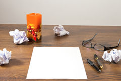 Desk with notepad. And candle Royalty Free Stock Image