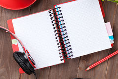 Desk with notepad, coffee and headphones Stock Images