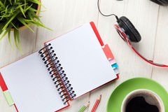 Desk with notepad, coffee and headphones Stock Photos