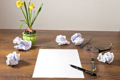 Desk with notepad. And flowers Royalty Free Stock Photography