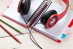 Desk with notepad and headphones Stock Image