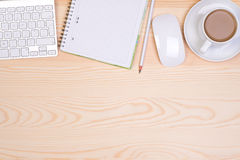 Desk with notepad, keyboard, mouse, pencil and a cup of coffee Royalty Free Stock Photos