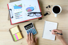 Desk office business financial Graph analysis with laptop Royalty Free Stock Images