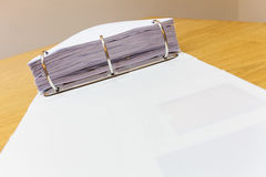 Desk in an office with folder full of papers background Royalty Free Stock Images