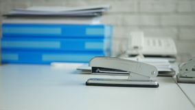 Desk Office Image with Archived Documents and a Stapler Used for Paper Stapling.  stock photo