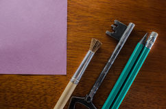 Desk with office supplies. On a wooden table in the office, lie pencils,items key sticker for school of business education Stock Image