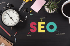 Desk office with wording searching engine optimizing SEO. Royalty Free Stock Images