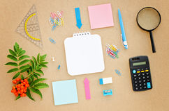Desk with paper, pen, calculator, magnifier and ruler Stock Images