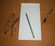 Desk with pen and paper stock image