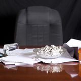 Desk with pile of cigarettes Royalty Free Stock Image