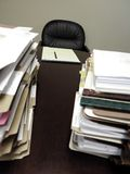 Desk with Piles of Files Stock Photo