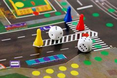Desk play road rules with chips and cubes Royalty Free Stock Images