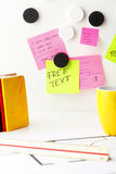 Desk with 'Post It' notes. Office work area. Desk with pink and yellow 'Post It' notes Royalty Free Stock Photos