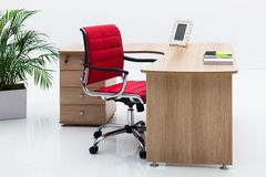 Desk and red armchair Royalty Free Stock Images