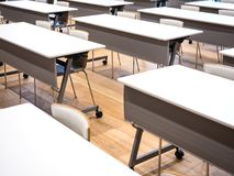 Desk in row Study room Campus Education Stock Images