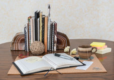 Desk Scene With Open Journal. Cup of tea royalty free stock images