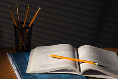 Desk with school book in night Royalty Free Stock Photo