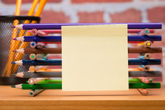 Desk with school supplies and colored pencil Royalty Free Stock Photo