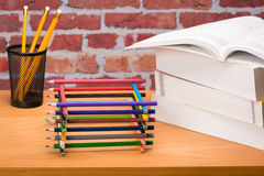 Desk with school supplies and colored pencil Royalty Free Stock Images