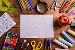 Desk, school supplies, empty paper, wooden background, copy spac Royalty Free Stock Photography