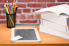 Desk with school supplies and slate Stock Photos