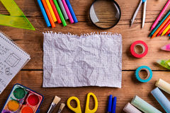 Desk, school supplies, squared paper, wooden background, copy sp Stock Image