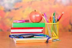 Desk with a stack of books Stock Photo