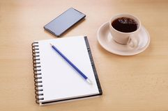 Desk with stationery phone and cup of coffee Stock Image