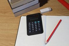 Desk with study materials. View from above of a desk with study materials and aids in landscape format Stock Photos