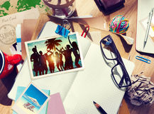 Desk with Summer Photographs and Notebook Royalty Free Stock Photography