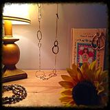 Desk. Sunflowers and Jewelry Royalty Free Stock Image