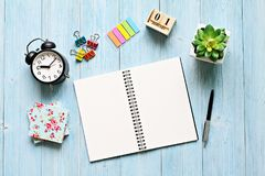 Desk table with open notebook paper, cube calendar and clock Stock Images