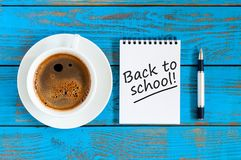 Desk of teacher or student with morning coffee cup with notice - Back to school. Education concept, 1 september time.  stock photos