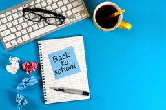 Desk of teacher or student with morning coffee cup with notice - Back to school. Education concept, 1 september time.  stock images