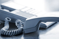 Desk telephone off hook Royalty Free Stock Photo