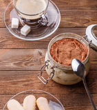 Desk with tiramisu, biscuits, coffee Stock Photo