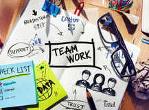 Desk with Tools and a Notebook with Ideas About Teamwork Stock Images