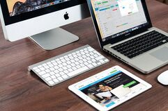 Desk top, laptop computers and iPad royalty free stock photos