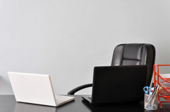 Desk with two laptops Stock Photography