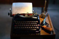 Desk with typewriter and gun Royalty Free Stock Photography